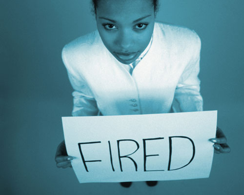 Businesswoma Holding Fired Sign Board
